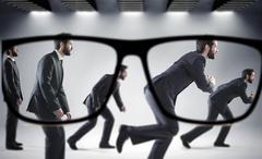 Focus on the numerous businessmen - stock photo