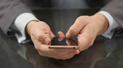Boss using expensive smartphone, thumb touching screen closeup Stock Footage