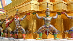 Giant Statue Around Pagoda In Wat Phra Kaew Temple Of Thailand (pan shot) Stock Footage