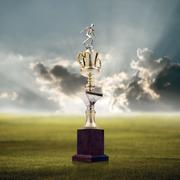 Football trophy with nice landscape background, Success concept - stock photo