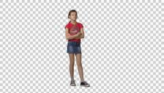 Little girl in red t-shirt stands, looks, waits somebody. Green screen footage Stock Footage