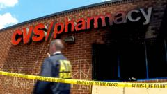 ATF agents at charred riot scene at CVS in Baltimore, MD  Stock Footage