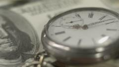 One hundred dollar bill, pocket watch closeup. Time is money Stock Footage
