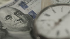 U.S. one hundred dollar bill, pocket watch. Time, money system - stock footage