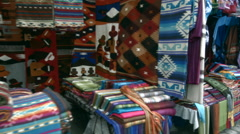 Traditional handicraft market in Otavalo, Ecuador Stock Footage