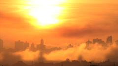 Sunrise. Silhouette buildings and golden sun. Fog. End of the world. - stock footage