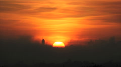 Quite morning. Silhouette buildings and golden sun. Smoke, Warm, pollution - stock footage