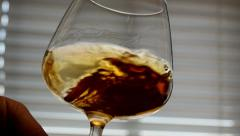 Swirling brandy in glass, slow motion CU Stock Footage