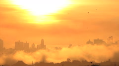 Morning. Silhouette buildings and golden sun. Fog. End of the world. - stock footage