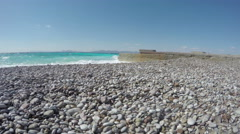 Beautiful resort beach with  pebbles and pier in Rhodes, Greece.  Timelapse 4K Stock Footage