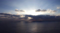 4K Time Lapse of Sunshine through Heavenly Clouds over Ocean Stock Footage