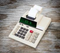 Old calculator showing a percentage - 30 percent - stock photo