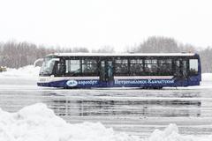 Airfield bus transports passengers at airport Petropavlovsk-Kamchatsky - stock photo