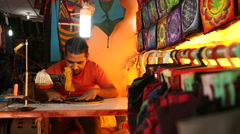 Indian man sewing using sewing machine in workshop. Stock Footage