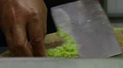 Cutting onion and ginger for lotus roots cake Stock Footage