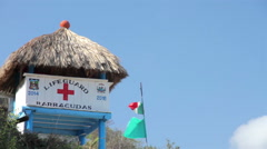 FULL SHOT. Lifeguard post near to the beach, flags waving. Stock Footage