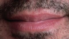 Stock Video Footage of Unshaven Adult Male Smiling Lips Macro Close Up Footage.
