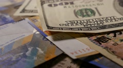 Several currencies turning Stock Footage