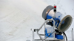 Blue snowblower on standby on a resort Stock Footage