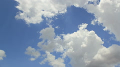 Time lapse rolling clouds. Sunny day. Blue sky Stock Footage