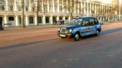 A London taxi slowly moving along the streets - stock footage