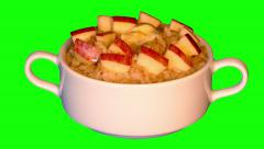 4k hot porridge with butter and pieces of apple in bowl Stock Footage