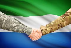 Stock Illustration of Soldiers shaking hands with flag on background - Sierra Leone