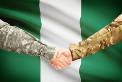 Soldiers shaking hands with flag on background - Nigeria - stock illustration