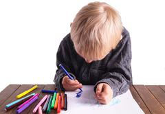 Little boy draws a drawing Stock Photos