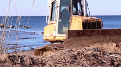 A machinery getting some soil from the lakeside Stock Footage