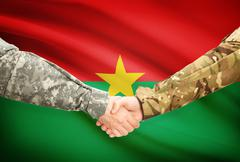 Stock Illustration of Soldiers shaking hands with flag on background - Burkina Faso