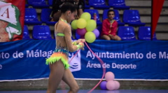Young gymnast with ribbons on rhythmic gymnastics tournament - stock footage