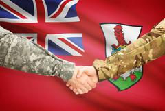 Stock Illustration of Soldiers shaking hands with flag on background - Bermuda