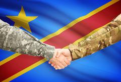 Stock Illustration of Soldiers shaking hands with flag on background - Congo-Kinshasa