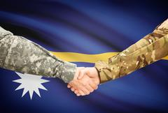 Stock Illustration of Soldiers shaking hands with flag on background - Nauru