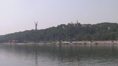 UKRAINE. KIEV. AUGUST 2011: View from the water. Kiev-Pechersk Lavra and Statue Stock Footage