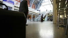 Copy space: briefcase in London train station Stock Footage