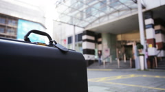 Copy space: briefcase in front of office Stock Footage