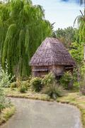 Small hut with a thatched roof Stock Photos