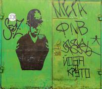 Vandalised Green Garage Door - stock photo