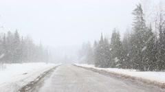 Winter road - hard snowfall Stock Footage