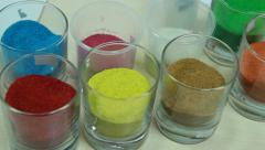 Colourful sand for art - in glasses Stock Footage