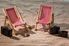 Deckchair on a sandy beach Stock Photos