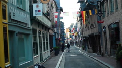 The view of people walking on pedestrian street in French town. Normandy. 2 shot Stock Footage