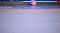 Gymnast legs on the field with ribbons in rhythmic gymnastics tournament Stock Footage