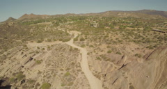 Aerial Shot of Vasquez Rocks with Cars Stock Footage