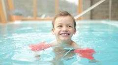 Kid swimming in spa, happy kid in a pool - stock footage