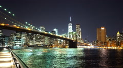 City lights of Manhattan reflecting on Hudson River Stock Footage
