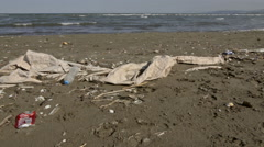 Dirty beach, Rubbish and plastic on a beach Stock Footage