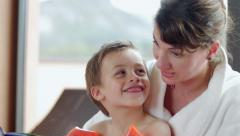 Young mother reading tale to kid in spa Stock Footage